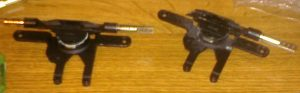 The new hinge (left) and the old, broken hinge (right)